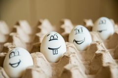 Two funny smiling eggs in a packet. Stock Photo