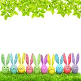 Easter eggs funny bunny green grass Spring tree branches Stock Images