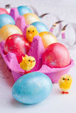 Easter eggs and funny chickens. Stock Photo