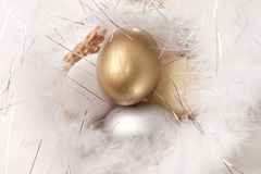 Easter eggs on fur background. Golden, silver, white and yellow colors Stock Photos