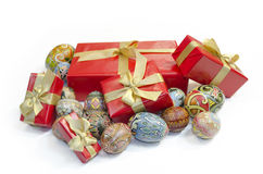 Easter eggs and gifts boxes Stock Images