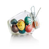 Easter eggs in glass jar Stock Image