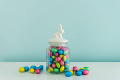 Easter eggs in glass jar royalty free stock photography