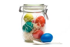 Easter eggs in glass jar stock images