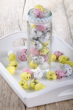 Easter eggs in a glass and tray Royalty Free Stock Image