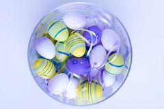 Easter eggs in glass vase. Pink or purple Stock Images