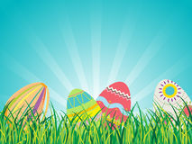 Easter Eggs on Glasses with Blue Sky Background Royalty Free Stock Photo