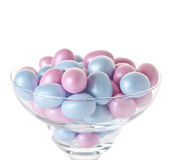 Easter eggs in glasswares. Easter eggs in glassware on a white background Royalty Free Stock Image