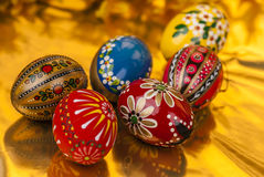 Easter eggs on gold background horizontal Royalty Free Stock Photography
