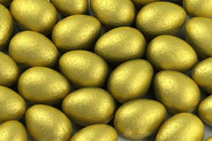 Easter eggs in gold foil Stock Images