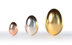 Easter Eggs Gold Silver Bronze. Gold Silver and Bronze Easter Eggs on a white Background Stock Photos