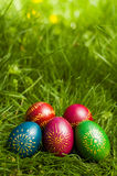 Easter eggs on grass. Colorfull Easter Eggs on the grass with out of focus background for copyspace Royalty Free Stock Image