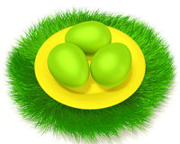 Easter eggs on grass. Green Easter eggs in a yellow plate on the green grass Stock Photo