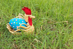 Easter eggs in the grass. Blue easter eggs in hen basket at Green grass Stock Photo