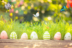 Easter eggs. In grass against blurred green background. Spring holidays concept stock image