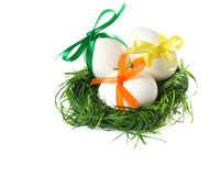 Easter eggs in grass basket. On white background Stock Photography