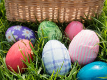 Easter eggs on grass. Basket background Stock Image
