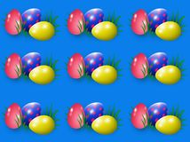 Easter. Eggs in the grass on a blue background Royalty Free Stock Image