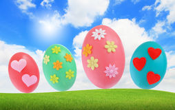 Easter eggs on grass with blue sky Royalty Free Stock Photos
