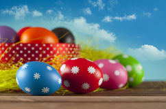 Easter eggs on the grass and blue sky background Stock Photo