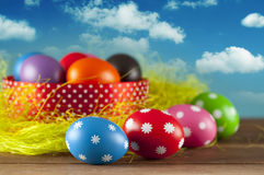 Easter eggs on the grass and blue sky background Royalty Free Stock Photos