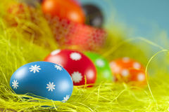 Easter eggs on the grass and blue sky background Royalty Free Stock Photography
