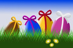 Easter eggs in the grass with blue sky Stock Photo