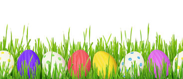 Easter eggs and grass border. On white background. Seamless pattern stock images