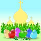 Easter eggs with grass and church domes. Stock Photography