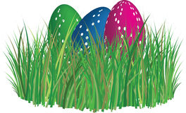 Easter eggs in grass. 3D colored and ornated easter eggs laying in the grass field Stock Photos