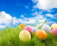Easter eggs in grass. Decorated easter eggs in grass on sky background Stock Photos