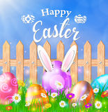 Easter eggs on a grass field with flower. On wooden fence background. Rabbit ears sticking out of the egg. Vector illustration Stock Images