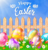 Easter eggs on a grass field with flower. On wooden fence background. Vector illustration Stock Images