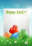 Easter eggs on a grass field with white paper. Vector illustration Stock Photos