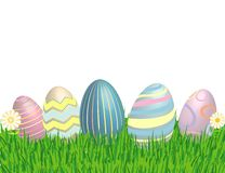 Easter Eggs in the grass with flowers! Stock Photo