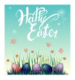 Easter eggs on the grass and flowers. Vector illustration. Beautiful lettering Happy Easter. Easter eggs on the grass and flowers. Beautiful lettering Happy Stock Photo