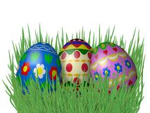 Easter eggs on grass isolated on white Stock Photo