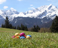 Easter eggs in grass in the mountains Royalty Free Stock Image