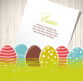 Easter eggs with grass and paper Stock Photo