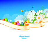 Easter eggs with grass and ribbon Royalty Free Stock Images