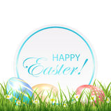 Easter eggs in the grass and round card Stock Photos