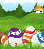 Easter eggs in the grass and rural house Stock Images