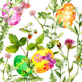 Easter eggs in grass. Seamless pattern with flowers, butterflies. Watercolor. Easter eggs in grass. Seamless pattern with flowers and butterflies. Watercolor Stock Photos