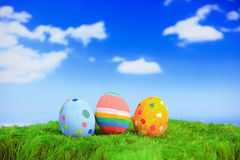 Easter eggs on grass with sky Royalty Free Stock Photo