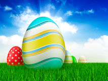 Easter eggs on grass and sky background Royalty Free Stock Photography