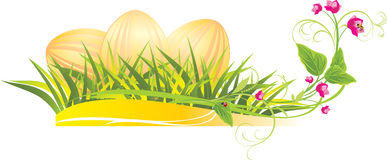 Easter eggs in the grass with spring flowers stock photo