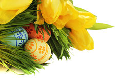 Easter eggs in grass with tulips Stock Photography
