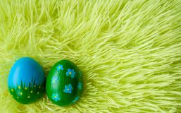 Easter eggs on a grass. Two Easter eggs on a green grass Stock Photos