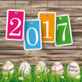 Easter Eggs Grass Worn Wood Price Stickers 2017. Price stickers with date 2017 on the wooden background with easter eggs in the grass Royalty Free Stock Photo