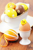 Easter eggs in a gravy boat with a chicken sitting in egg Stock Images